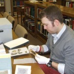 Matthew Saunders exploring the Ramsey Family Papers at the Cleveland Bradley County Library History Branch.